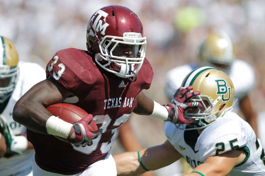 Christine Michael (33) of the Texas A&M Aggies runs during a game against the Baylor Bears at Kyle Field in College Station, Texas, on Oct. 15, 2011.