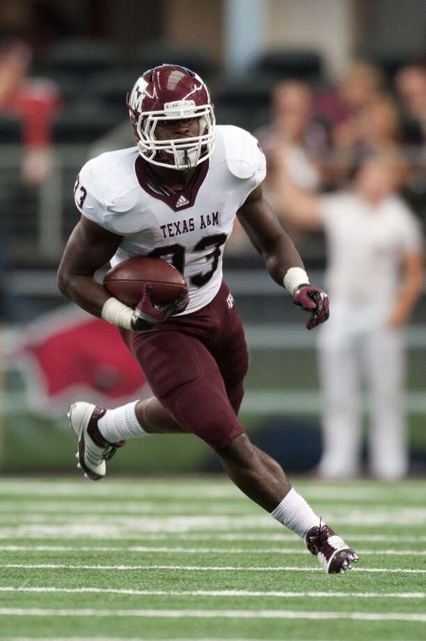 Running back Christine Michael (33) of the Texas A&M Aggies rushes during a game against the Arkansas Razorbacks at Cowboys Stadium  in Arlington, Texas, on Oct. 1, 2011.