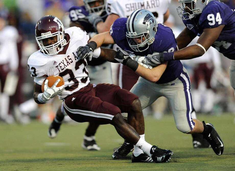 Linebacker John Houlik #39 of the Kansas State Wildcats tackles running back Christine Michael (33) of the Texas A&M Aggies for a loss in the first quarter on Oct. 17, 2009 at Bill Snyder Family Stadium in Manhattan, Kan.