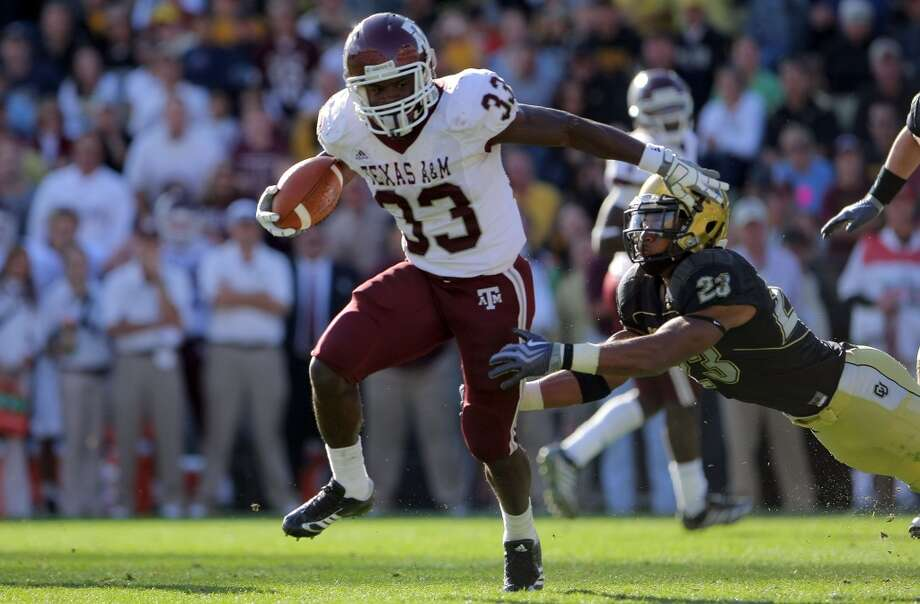Running back Christine Michael (33) of the Texas A&M Aggies rushes against the Colorado Buffaloes during action at Folsom Field in Boulder, Colo., on Nov. 7, 2009. Colorado defeated Texas A&M 35-34.