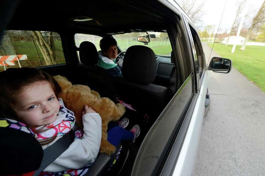Hayden France, 4, left. and her mother Melissa France drive in to the St. Colman's daycare center April 26, 2013,  in Colonie, N.Y.    (Skip Dickstein/Times Union) Photo: SKIP DICKSTEIN
