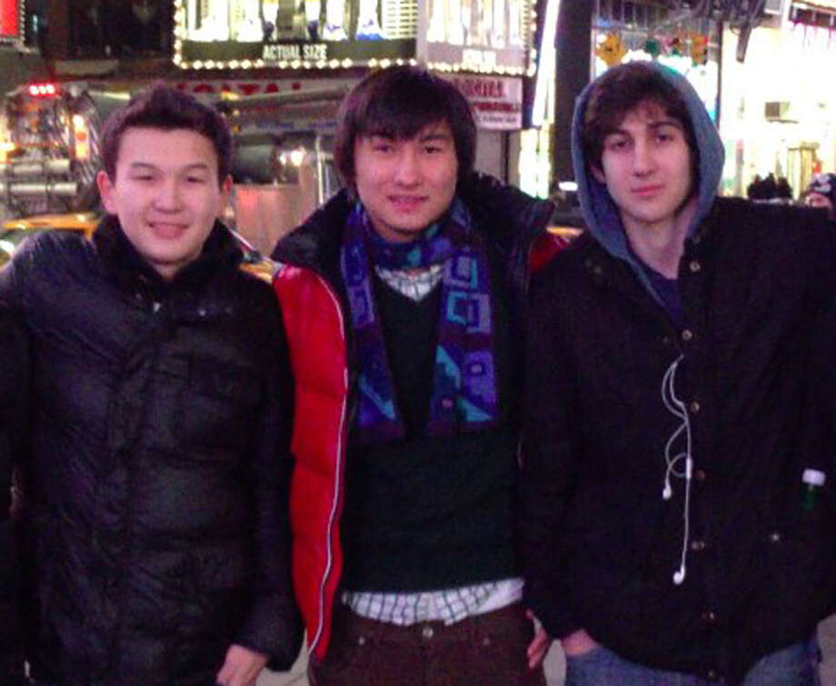 This undated photo added on April 18, 2013 to the VK page of Dias Kadyrbayev shows, from left, Azamat Tazhayakov and Dias Kadyrbayev, from Kazakhstan, with Boston Marathon bombing suspect Dzhokhar Tsarnaev in Times Square in New York. Kadyrbayev and Tazhayakov, two college buddies of Tsarnaev, were jailed by immigration authorities the day after Tsarnaev's capture. They are not suspects, but are being held for violating their student visas by not regularly attending classes, Kadyrbayev's lawyer, Robert Stahl said. They are being detained at a county jail in Boston. (AP Photo/VK) Photo: Uncredited, Associated Press / Uncredited