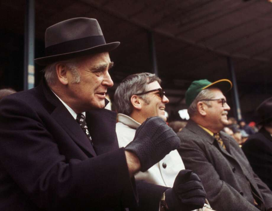 Oakland Athletics owner Charlie O. Finley, left, watches a game against the Chicago White Sox in Oakland in this April 11, 1973 photo.