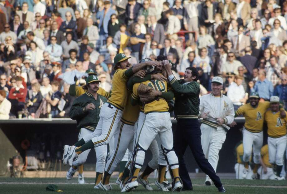Members of the Oakland Athletics celebrate after winning Game 7 of the 1973 World Series against the New York Mets on October 21, 1973 at Oakland-Alameda County Coliseum in Oakland, California.  The A's defeated the Mets 5-2.