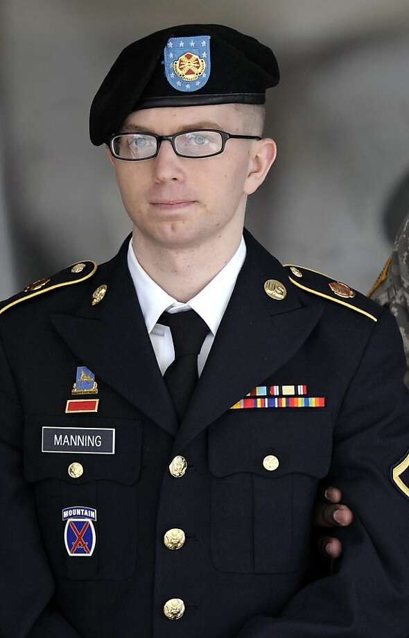 In this March 15, 2012 file photo, Army Pfc. Bradley Manning departs a courthouse in Fort Meade, Md.  A military judge refused on Thursday, April 26, 2012, to dismiss the most serious charge against Manny, accused in the biggest leak of government secrets in U.S. history. Photo: Cliff Owen, Associated Press