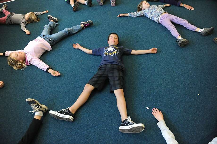 Lynn Cheatham guides students at the Bolinas-Stinson Beach School in mindfulness. One goal is to increase empathy and reduce bullying. Photo: Susana Bates, Special To The Chronicle