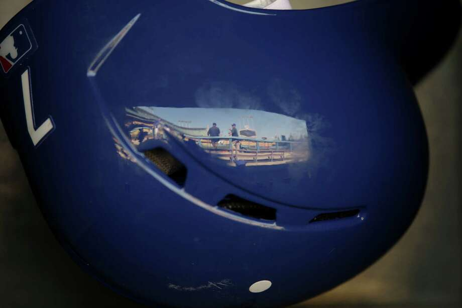 The Dodger Stadium is reflected in a helmet before a baseball game between the Los Angeles Dodgers and the Milwaukee Brewers in Los Angeles, Friday, April 26, 2013. (AP Photo/Jae C. Hong) Photo: Jae C. Hong, Associated Press / AP