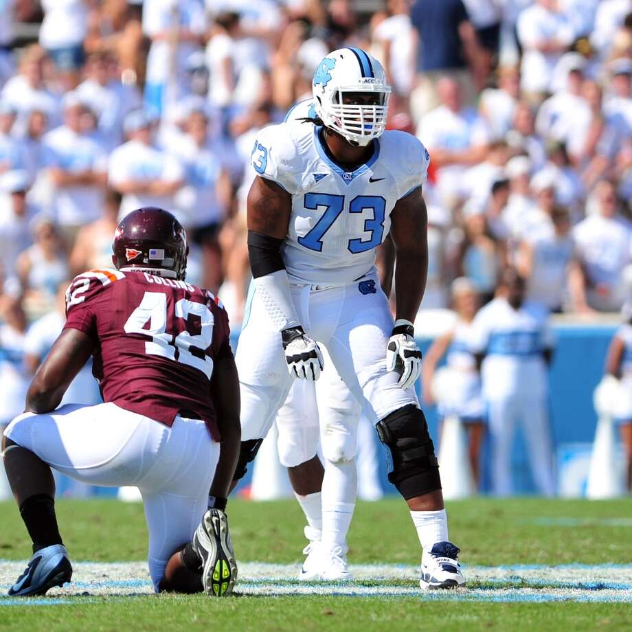 3rd roundNorth Carolina offensive tackle Brennan Williams blocks in an ACC matchup against Virginia Tech. Photo: Lance King, Getty Images