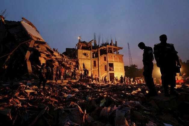 Bangladeshi soldiers stand in the rubble at the site of a building that collapsed Wednesday in Savar, near Dhaka, Bangladesh, Friday, April 26, 2013.  (AP Photo/Kevin Frayer) Photo: Kevin Frayer, Associated Press / AP