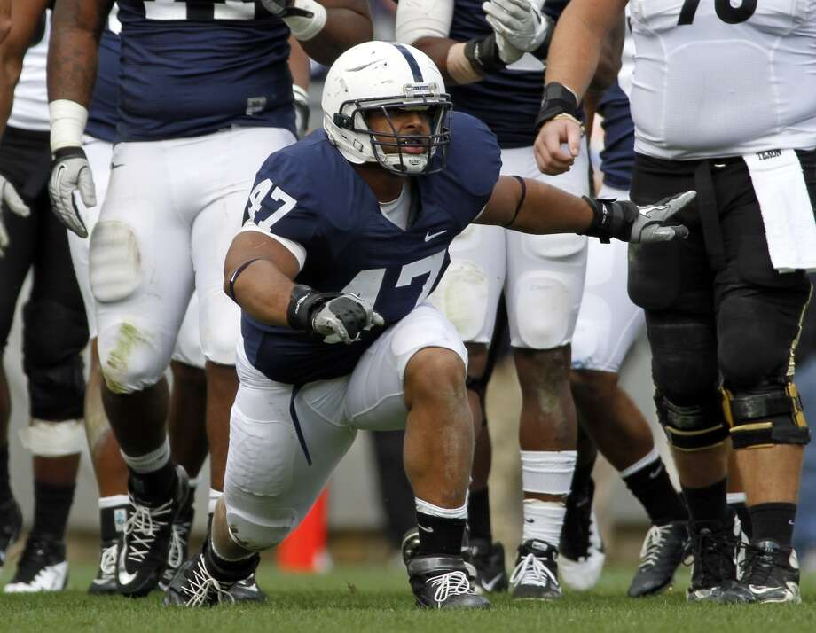 Jordan Hill (47) of the Penn State Nittany Lions celebrates his tackle against the Purdue Boilermakers during a game on Oct. 15, 2011 at Beaver Stadium in State College, Pa.