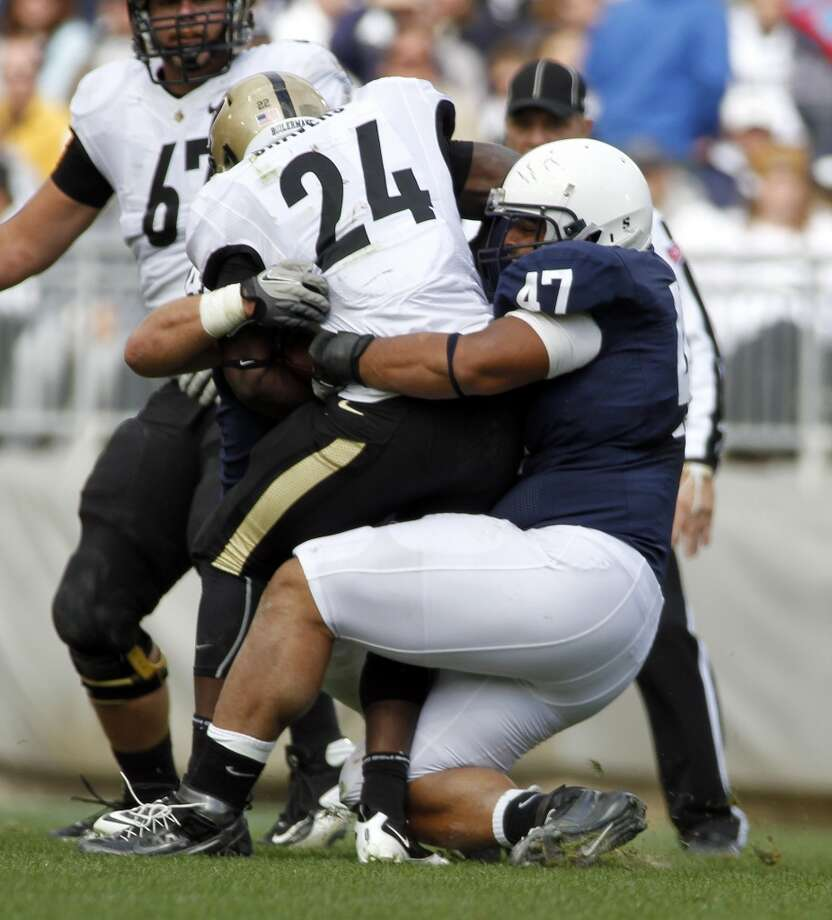 Jordan Hill (47) of the Penn State Nittany Lions tackles Akeem Shavers (24) of the Purdue Boilermakers during a game on Oct. 15, 2011 at Beaver Stadium in State College, Pa.