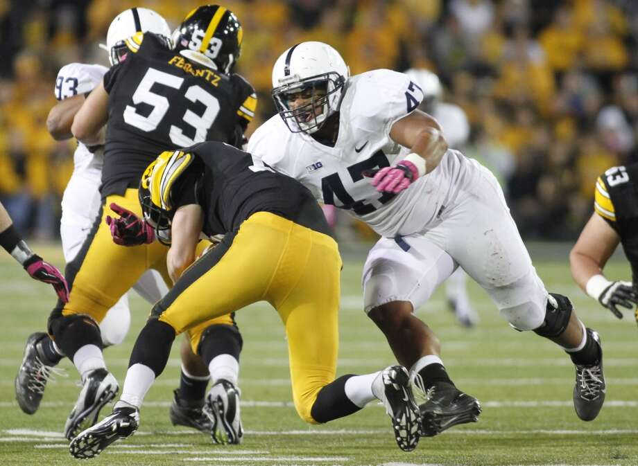 Defensive tackle Jordan Hill (47) of the Penn State Nittany Lions moves in for a sack of quarterback James Vandenberg (16) of the Iowa Hawkeyes during the second quarter on Oct. 20, 2012 at Kinnick Stadium in Iowa City, Iowa.