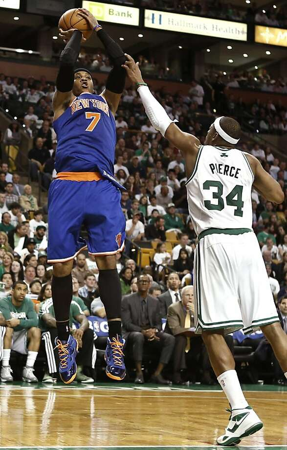 New York Knicks' Carmelo Anthony (7) shoots over Boston Celtics' Paul Pierce during the third quarter of Game 3 of a first-round NBA basketball playoff series in Boston, Friday, April 26, 2013. (AP Photo/Winslow Townson) Photo: Winslow Townson, Associated Press