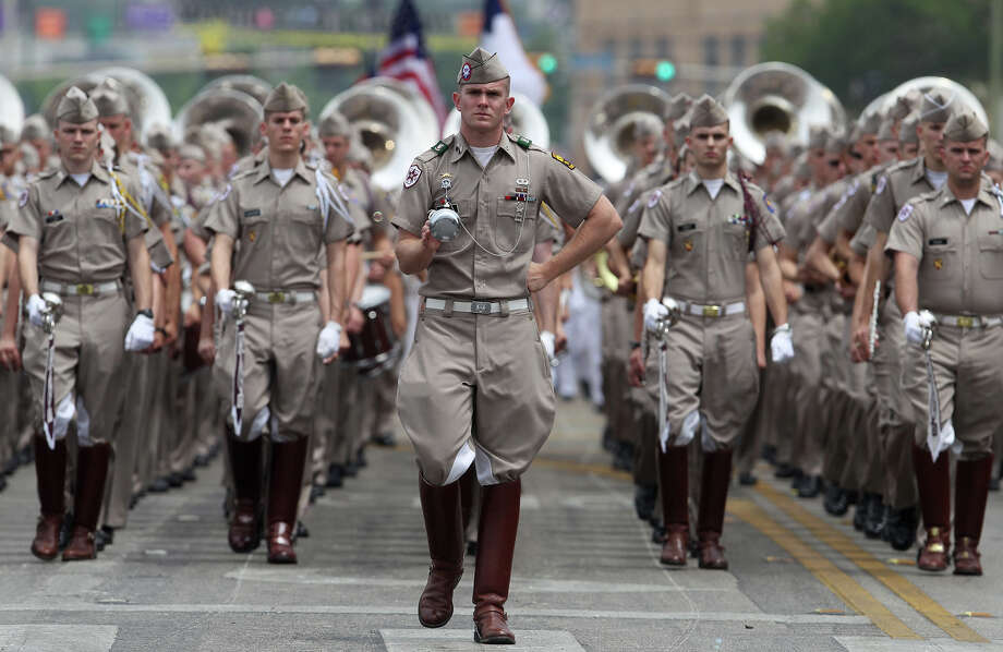 The Texas A&M band marches down Broadway Friday April 26, 2013 during the Battle of Flowers parade during the annual Fiesta celebration. Photo: SAN ANTONIO EXPRESS-NEWS / ©San Antonio Express-News/Photo may be sold to the public