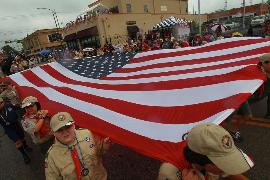 Boy Scouts carry a large American flag down Broadway during the 2013 Battle of Flowers parade. Photo: SAN ANTONIO EXPRESS-NEWS / ©San Antonio Express-News/Photo may be sold to the public