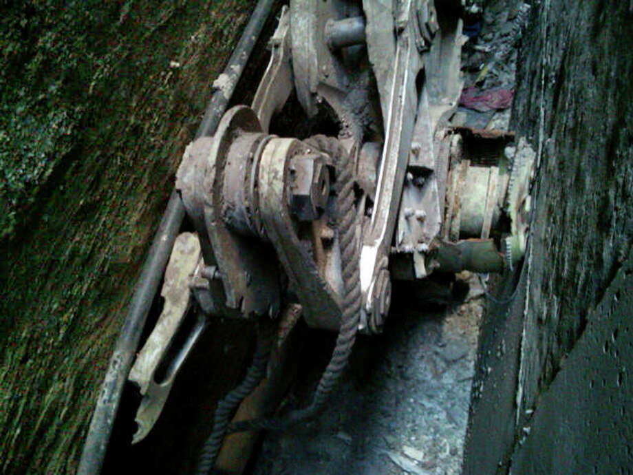 This Friday, April 26, 2013, photo provided by the New York City Police Department shows a piece of landing gear that authorities believe belongs to one of the airliners that crashed into the World Trade Center on Sept. 11, 2001, that was found wedged between a mosque and another building, in New York. Police say the medical examiner's office will complete a health and safety evaluation to determine whether to sift the soil around the buildings for possible human remains. (AP Photo/New York City Police Department)