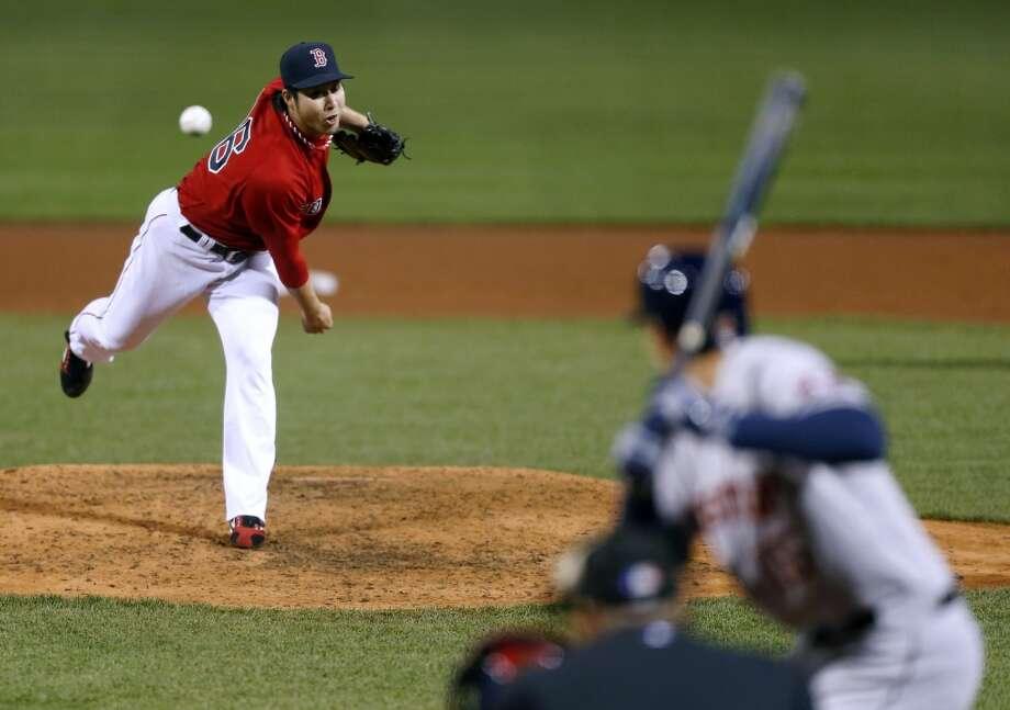 Junichi Tazawa of the Red Sox pitches to the Astros.