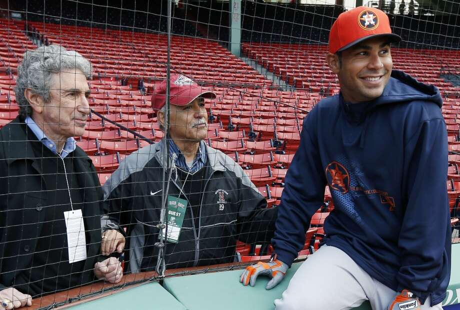 Before the game, Carlos Pena of the Astros visits with his father Felipe and family friend Julian Rich.