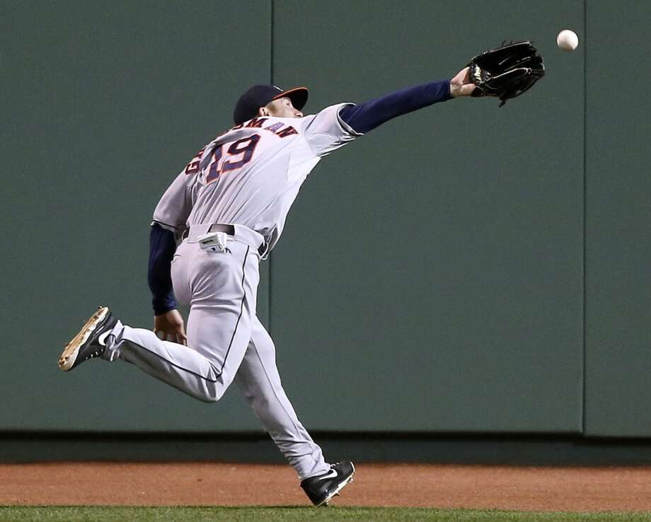 Astros outfielder Robbie Grossman chases a Red Sox hit.