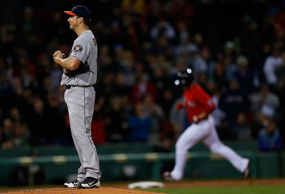 David Ross of the Red Sox rounds the bases after hitting a home run off Erik Bedard of the Astros.