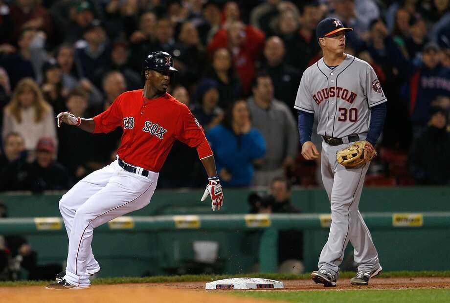 Pedro Ciriaco of the Red Sox reaches third base on a triple.