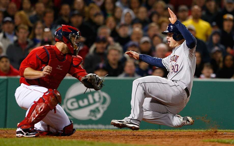 Matt Dominguez of the Astros slides into third base against the Red Sox. Photo: Jim Rogash, Getty Images