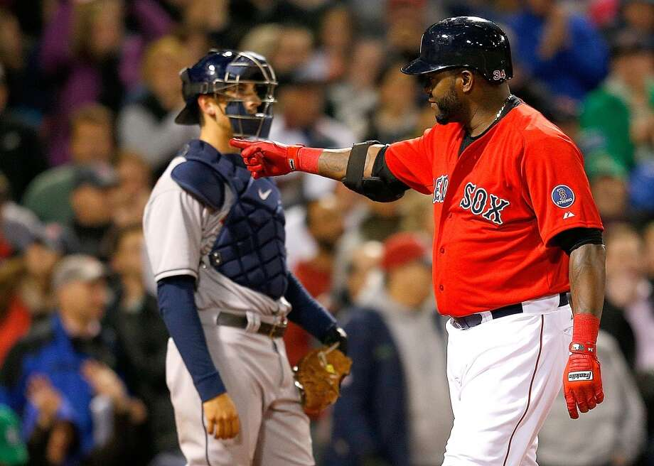 David Ortiz of the Red Sox gestures after hitting a home run against the Astros. Photo: Jim Rogash, Getty Images