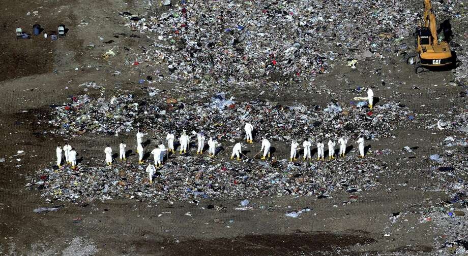 FBI agents search for evidence at a landfill near where  Boston Marathon bombing suspect Dzhohkar Tsarnaev lived. Photo: Jonathan Wiggs / Boston Globe