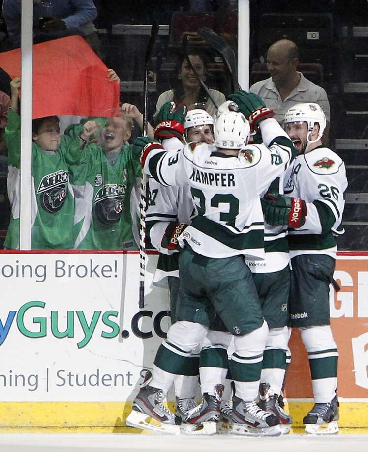 The  Aeros celebrate after right wing Justin Fontaine scored the Aeros second goal of the second period against the Grand Rapids Griffins .