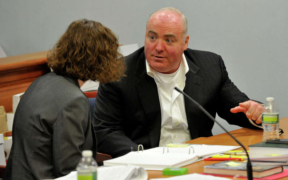 Michael Skakel, right, talks to Jessica Santos, one of his defense attorneys, at Skakel's habeas corpus trial at State Superior Court in Vernon, Conn., on Friday, April 26, 2013. Photo: Jason Rearick / Stamford Advocate