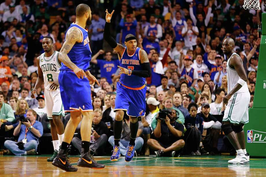 The Knicks' Carmelo Anthony gestures after scoring on an alley-oop for two his game-high 26 points. Photo: Jared Wickerham / Getty Images
