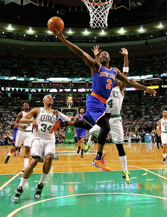 BOSTON, MA - APRIL 26: Raymond Felton #2 of the New York Knicks drives to the basket against the Boston Celtics during Game Three of the Eastern Conference Quarterfinals of the 2013 NBA Playoffs on April 26, 2013 at TD Garden in Boston, Massachusetts. NOTE TO USER: User expressly acknowledges and agrees that, by downloading and or using this photograph, User is consenting to the terms and conditions of the Getty Images License Agreement. (Photo by Jared Wickerham/Getty Images) Photo: Getty Images / 2013 Getty Images