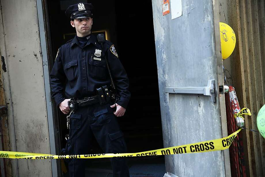 A police officer stands in front of the building on Park Place in lower Manhattan where a piece of landing gear believed to be from one of the planes destroyed in the September 11 attacks has been discovered on April 26, 2013 in New York City. The landing gear was discovered wedged between a mosque site and luxury high-rise apartment building, about three blocks north from the World Trade Center site.  Photo: Spencer Platt, Getty Images