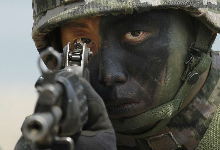 A South Korean Marine takes position during the joint military exercises between South Korea and the United States called Ssangyong 2013 as a part of annual Foal Eagle military exercises in Pohang, south of Seoul, South Korea, Friday, April 26, 2013.  Photo: Kin Cheung, Associated Press