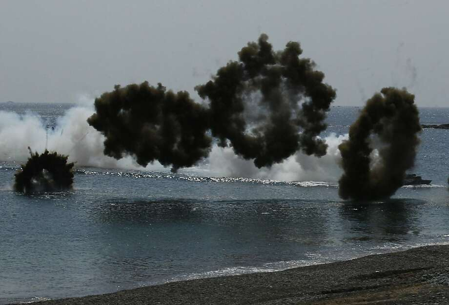 South Korean Marine LVT-7 landing craft sail to shores in a smoke screen during the U.S.-South Korea joint military exercises called Ssangyong 2013 as part of their two-month-long Foal Eagle military exercises in Pohang, south of Seoul, South Korea, Friday, April 26, 2013.  Photo: Kin Cheung, Associated Press