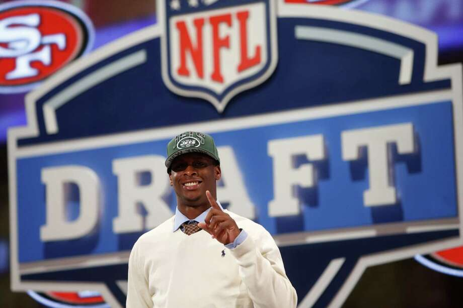 Geno Smith, a quarterback from West Virginia  gestures after being selected 39th overall by the New York Jets in the second round of the NFL Draft, Friday, April 26, 2013 at Radio City Music Hall in New York., Friday, April 26, 2013 at Radio City Music Hall in New York.  (AP Photo/Jason DeCrow) Photo: Jason DeCrow