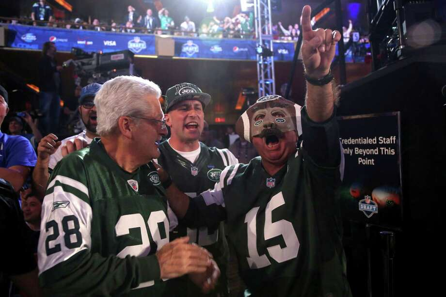 New York Jets fans watch as their team makes a selection during the second round of the NFL football draft on Friday, April 26, 2013, at Radio City Music Hall in New York. (AP Photo/Mary Altaffer) Photo: Mary Altaffer