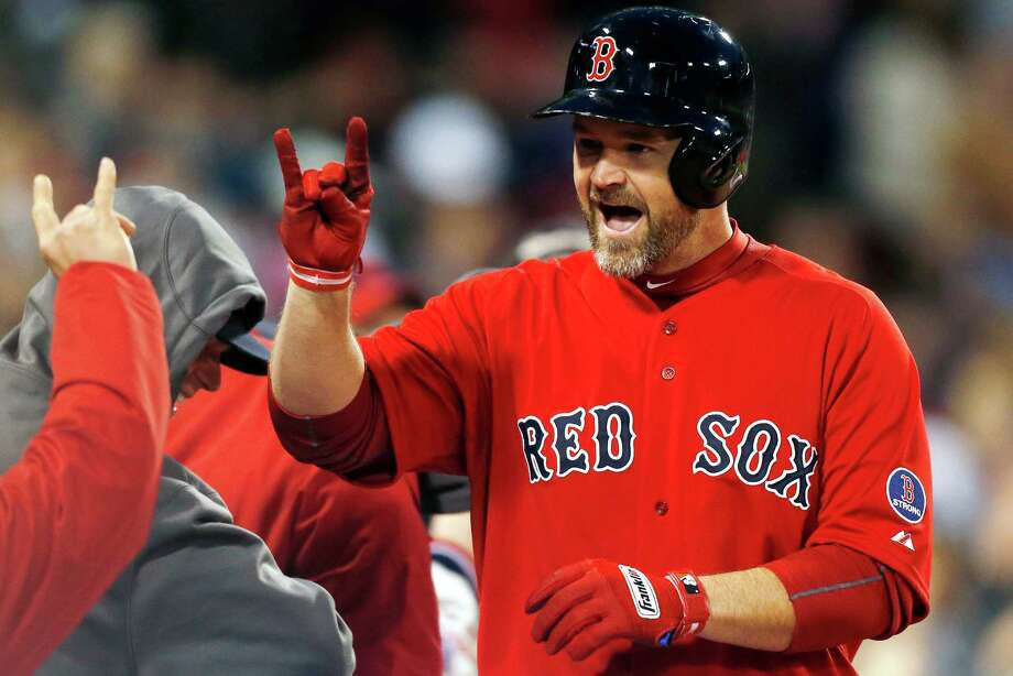 Boston Red Sox's David Ross celebrates his solo home in the second inning of a baseball game against the Houston Astros in Boston, Friday, April 26, 2013. (AP Photo/Michael Dwyer) Photo: Michael Dwyer