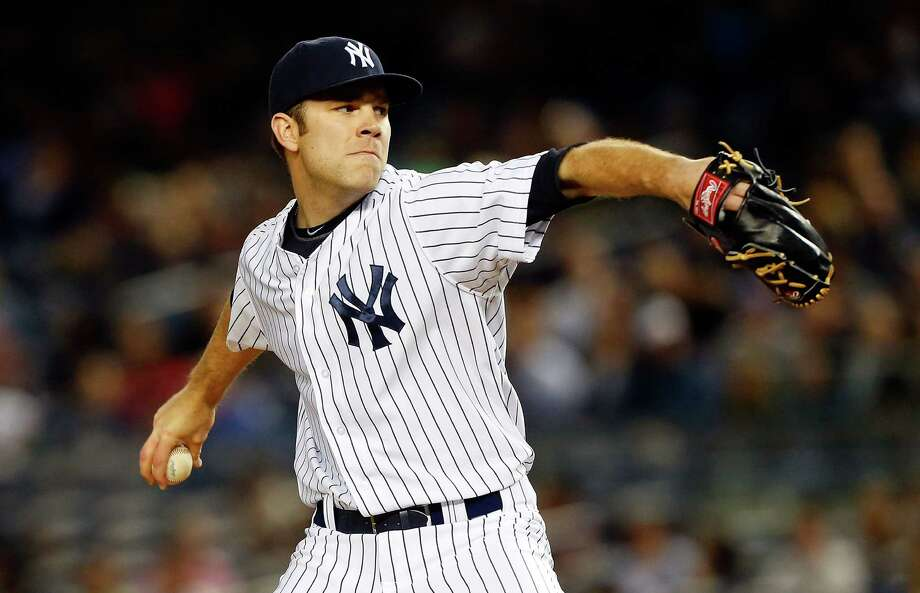 NEW YORK, NY - APRIL 26:  David Phelps #41 of the New York Yankees pitches in relief against the Toronto Blue Jays at Yankee Stadium on April 26, 2013  in the Bronx borough of New York City.  (Photo by Jim McIsaac/Getty Images) Photo: Jim McIsaac