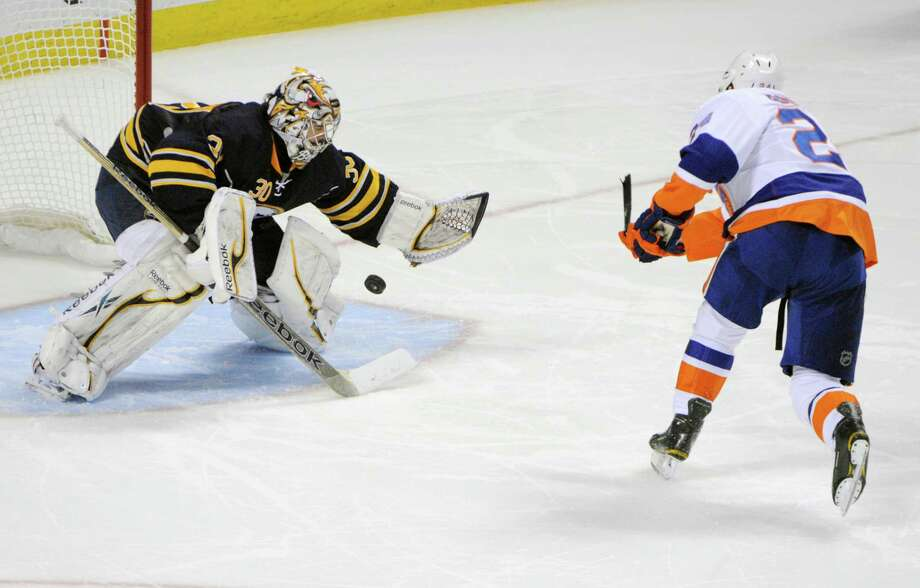 Buffalo Sabres goaltender Ryan Miller (30) stops New York Islanders right winger Brad Boyes (24) during the team shootout of an NHL hockey game in Buffalo, N.Y., Friday, April 26, 2013. Buffalo won, 2-1.  (AP Photo/Gary Wiepert) Photo: Gary Wiepert