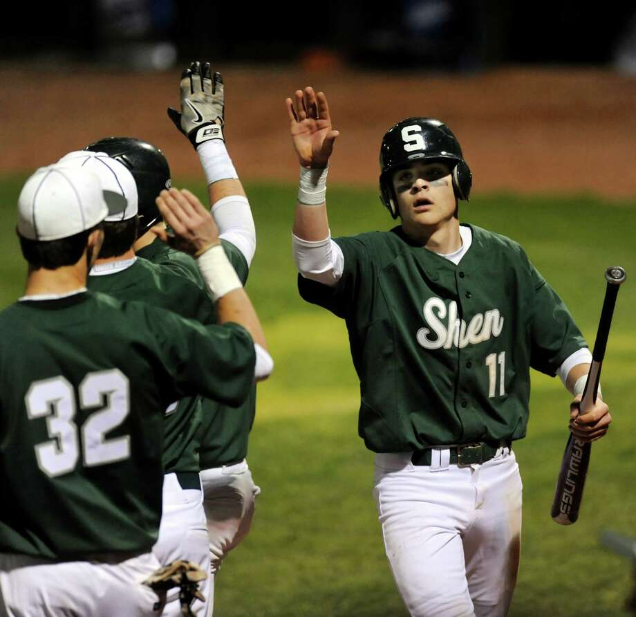 Shenendehowa's Brennan McCormack, right, celebrates his run with teammates during their baseball game against Shaker on Friday, April 26, 2013, at Joseph L. Bruno Stadium in Troy, N.Y. (Cindy Schultz / Times Union) Photo: Cindy Schultz / 10022156A