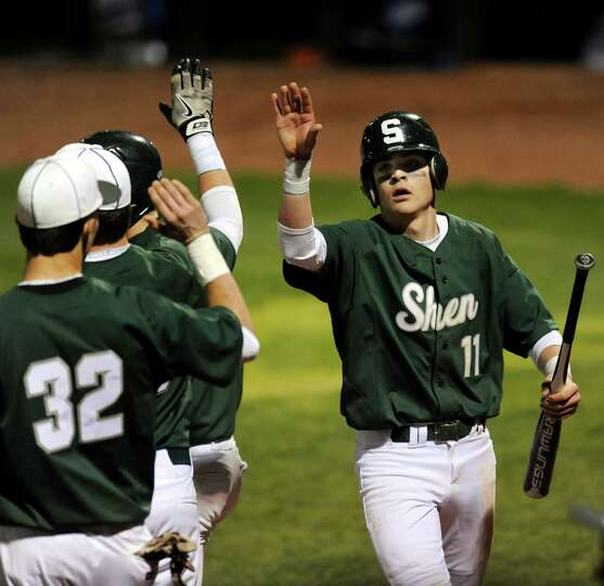 Shenendehowa's Brennan McCormack, right, celebrates his run with teammates during their baseball gam