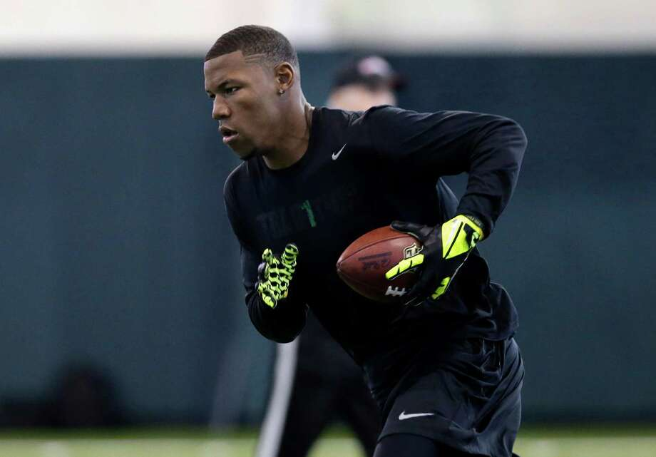 Baylor wide receiver Terrance Williams runs after making a catch as he works out for NFL scouts during a pro-day workout at Baylor University Wednesday, March 20, 2013, in Waco, Texas. (AP Photo/Tony Gutierrez) Photo: Tony Gutierrez, STF / AP