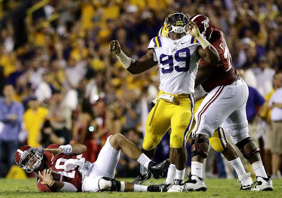 3rd roundLSU defensive end Sam Montgomery celebrates after sacking Alabama quarterback AJ McCarron. Photo: Bill Haber, Associated Press