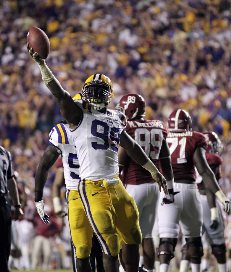 3rd roundSam Montgomery of LSU celebrates a recovered fumble when the Tigers played Alabama. Photo: Gerald Herbert, Associated Press