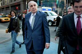 Carl Icahn, billionaire investor and chairman of Icahn Enterprises Holdings LP, center, walks outside of the Nasdaq MarketSite with Robert Greifeld, chief executive officer and president of Nasdaq OMX Group Inc., in New York, U.S., on Tuesday, March 27, 2012. Icahn announced his intention last month to offer $30 a share and give CVR Energy Inc. holders a right to as much as an additional $7 a share, a proposal that values the company at at least $2.6 billion, according to Bloomberg calculations. Photographer: Scott Eells/Bloomberg *** Local Caption *** Carl Icahn; Robert Greifeld