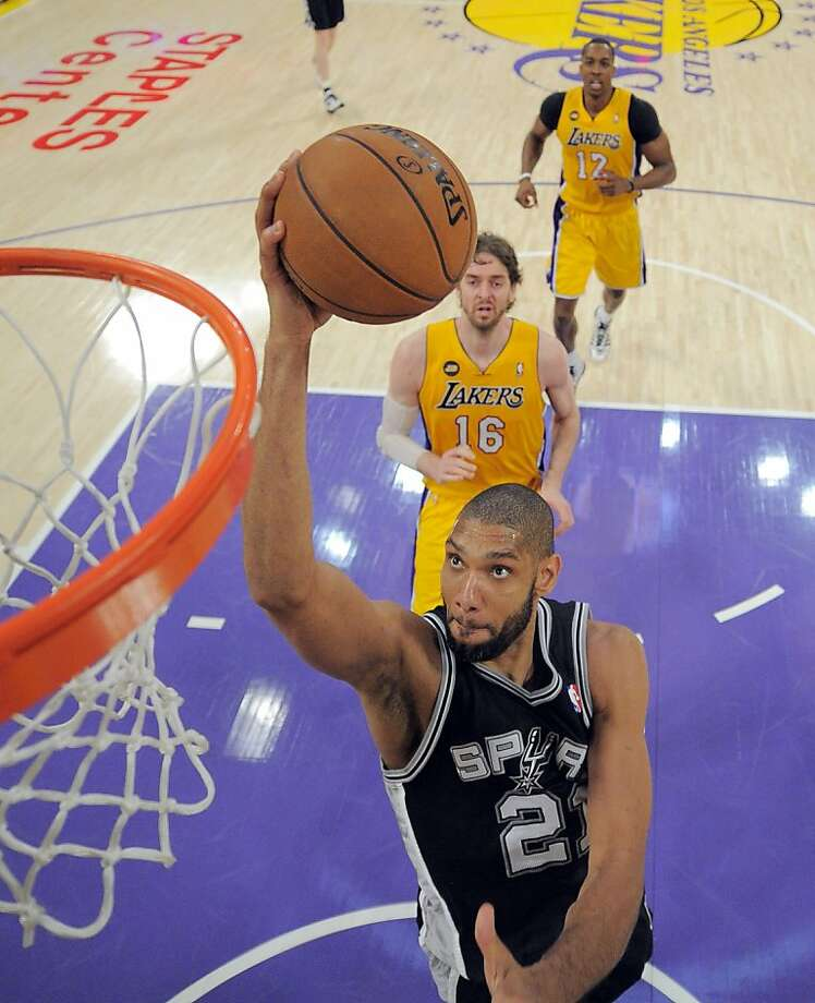 Spurs' Tim Duncan leaves Lakers' Pau Gasol and Dwight Howard way behind on his way to 26 points. Photo: Mark J. Terrill, Associated Press