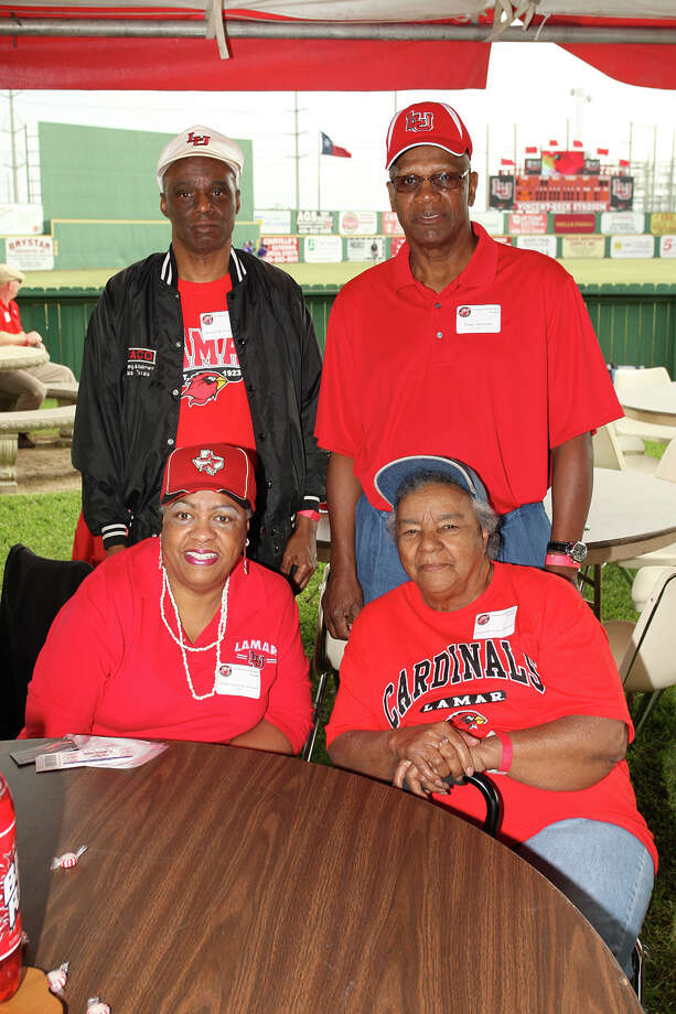 Kenneth Jackson, Tony Stewart, Phyllis Freeman-Stewart (front), and Espanola Evans Jackson (front) tailgate with the Lamar alumni before the baseball game Friday at Vincent-Beck Stadium. (Matt Billiot/Special to the Enterprise)