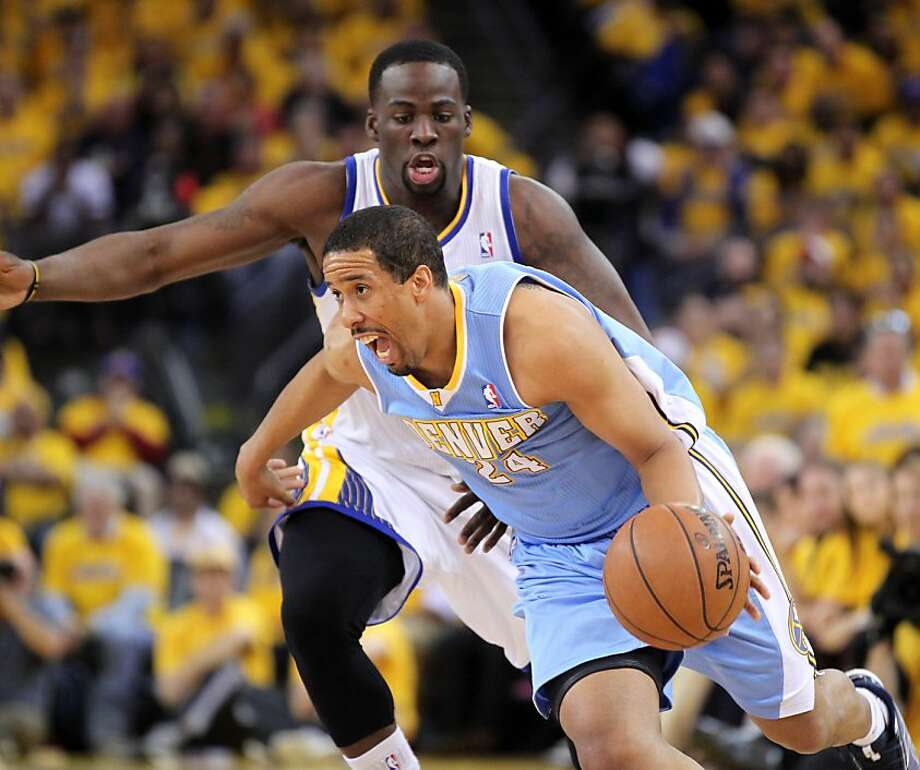 Denver's Andre Miller drives on Draymond Green in an April playoff game. Miller is in Nuggets coach Brian Shaw's doghouse. Photo: Lance Iversen, The Chronicle