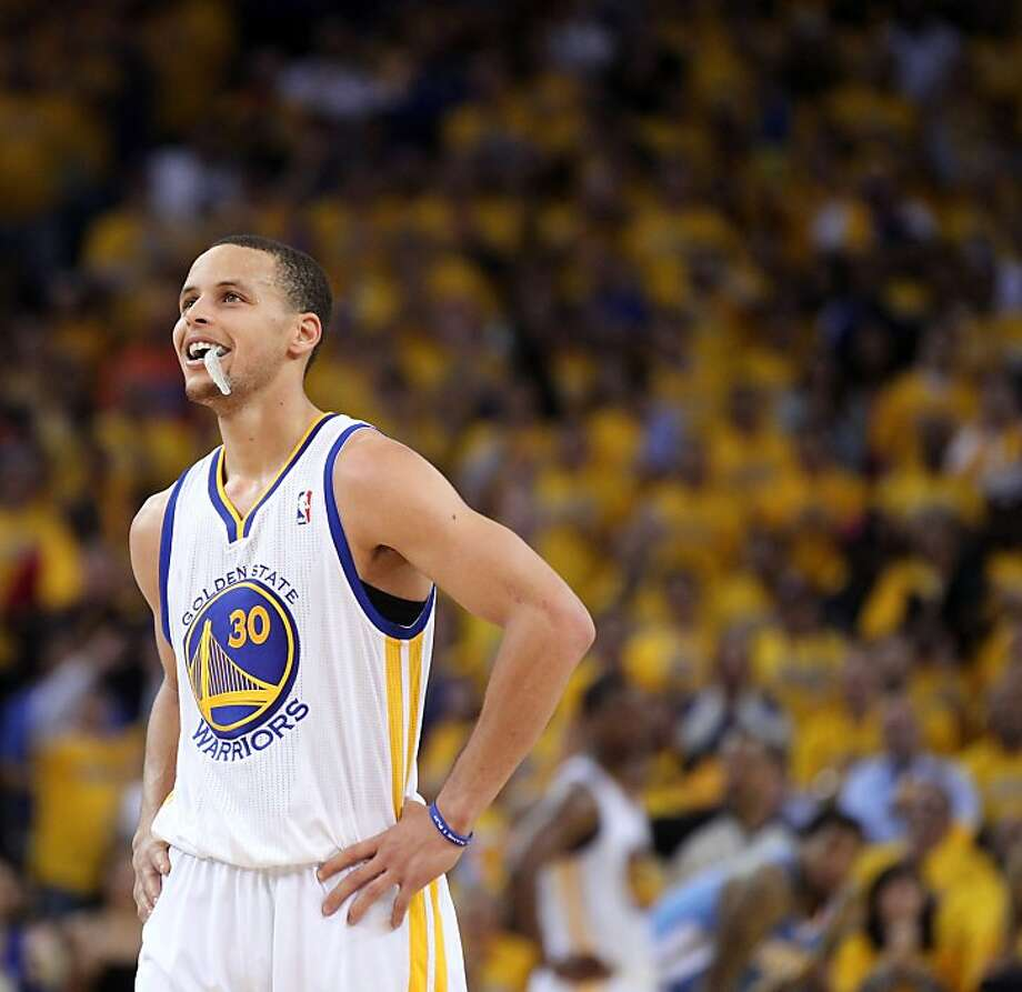 Stephen Curry (30) smiles after a three-point play in the second half. The Golden State Warriors played the Denver Nuggets in Game 3 of the first round of the NBA playoffs at Oracle Arena in Oakland, Calif., on Friday, April 26, 2013. The Warriors won the game 110-108 Photo: Lance Iversen, The Chronicle